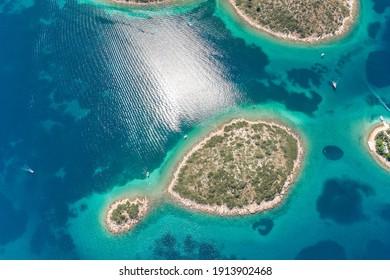 Aerial drone shot of Ricul Island near heart-shaped Galesnjak in Dalamatia Croatia