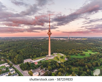 Aerial drone shot of the Tallinn TV Tower at summer evening at sunset.