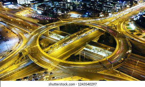 Aerial drone slow shutter night shot of urban elevated toll ring road junction and interchange overpass
