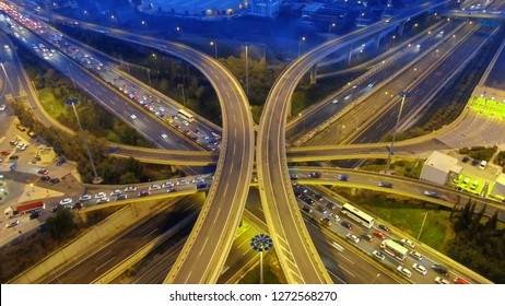Aerial drone slow shutter night shot of urban elevated toll ring road junction and interchange overpass passing through National Road