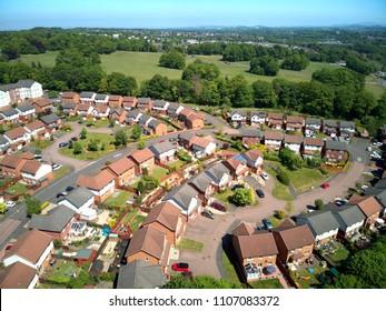 Aerial drone sunrise view of suburban houses in Edinburgh, Scotland, UK