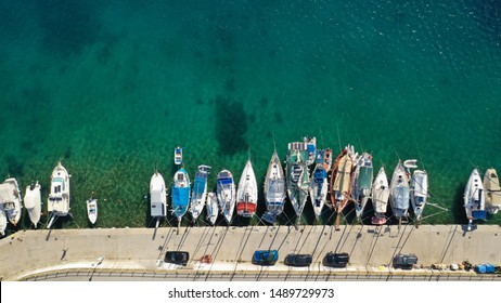 Aerial drone top down photo of small protected port of Porto Koufo with sail boats and yachts docked, Sithonia peninsula, Halkidiki, North Greece