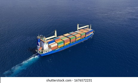 Aerial drone top down photo of fully loaded large truck size container tanker ship cruising the Mediterranean deep blue sea