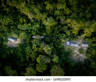 Aerial drone top down view of Indigenous Community in Amazon rainforest