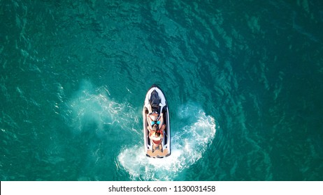 Aerial drone top view photo of Jet ski low speed cruising in tropical turquoise clear waters
