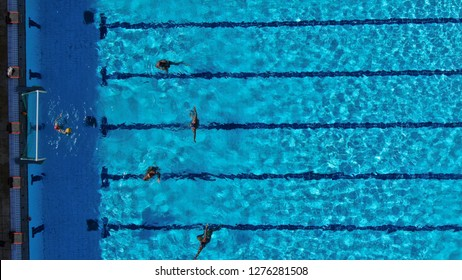 Aerial drone top view photo of people competing in waterpolo in turquoise water pool