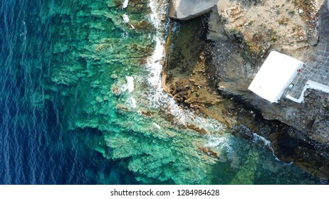 Aerial drone top view photo of picturesque chapel of Agios Nikolaos in old harbor of Mykonos island town, Cyclades, Greece