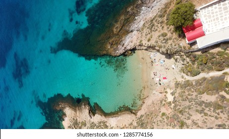 Aerial drone top view photo of beautiful turquoise seascape in area of Agios Sostis with famous small chapel, Mykonos island, Cyclades, Greece
