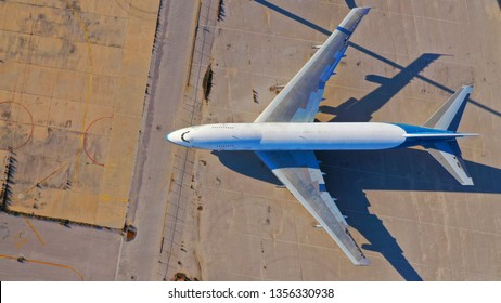 Aerial drone top view photo of abandoned passenger air plane in old airport no longer used