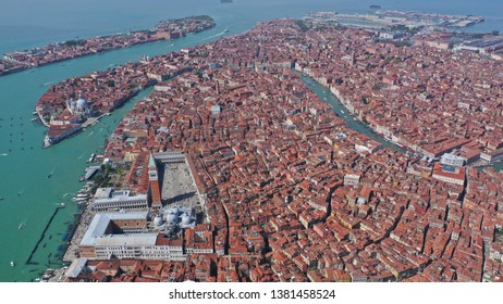 Aerial drone top view photo of iconic Saint Mark's square and Grand Canal in city of Venice as seen from high altitude, Italy
