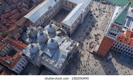 Aerial drone top view photo of iconic Basilica and Campanile in Saint Mark's square or Piazza San Marco, Venice, Italy