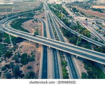 Aerial drone top view photo of highway multilevel junction interchange road. Israel.