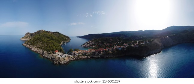 Aerial drone ultra wide panoramic view photo of beautiful and picturesque colorful traditional fishing village of Assos featuring iconic medieval castle, island of Cefalonia, Ionian, Greece
