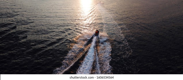 Aerial drone ultra wide photo of watercraft cruising in high speed in deep blue open ocean sea