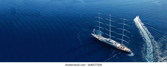 Aerial drone ultra wide photo of super sailing yacht in Monaco with deep blue sea, French riviera