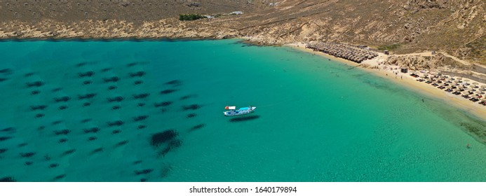 Aerial drone ultra wide photo of famous beach of Panormos in island of Mykonos, Cyclades, Greece
