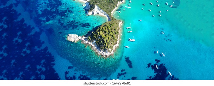 Aerial drone ultra wide photo of iconic small port and fishing village of Lakka with traditional Ionian architecture and sail boats, Paxos island, Ionian, Greece