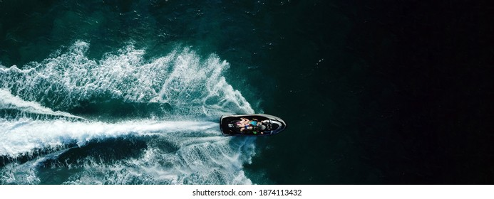 Aerial drone ultra wide photo of watercraft cruising in high speed in Caribbean tropical exotic turquoise crystal clear sea