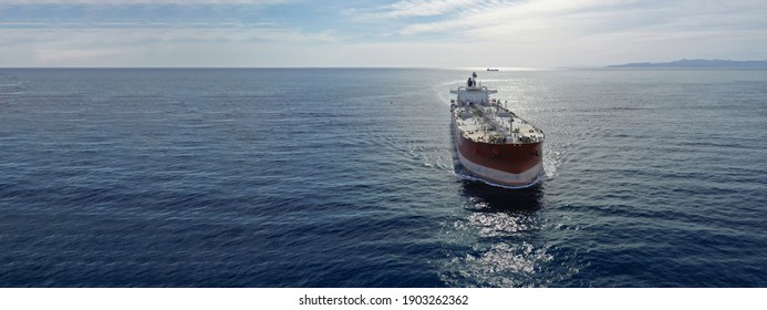 Aerial drone ultra wide photo of latest technology in safety standards crude oil tanker cruising Saronic Gulf deep blue sea, Greece