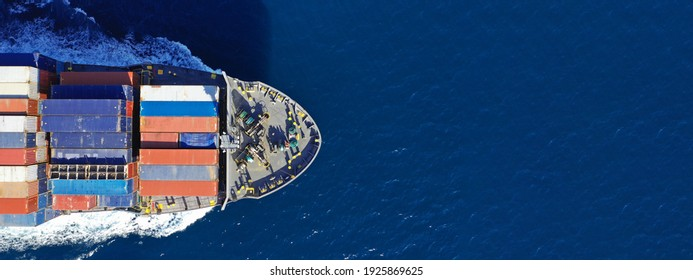 Aerial drone ultra wide photo of colourful truck size container tanker ship cruising deep blue sea near commercial port of Piraeus, Attica, Greece