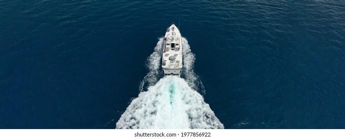 Aerial drone ultra wide photo of Hellenic Coastguard powerboat cruising in high speed near port of Piraeus, Attica, Greece