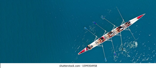 Aerial drone ultra wide top down photo of sport canoe with young team of athletes practising in deep blue open ocean sea