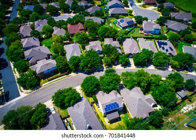 Aerial Drone View Above Austin Texas Suburb Summer Homes For Sale as Real Estate Ramps up in the Capital of Texas rooftop solar on homes in modern neighborhood