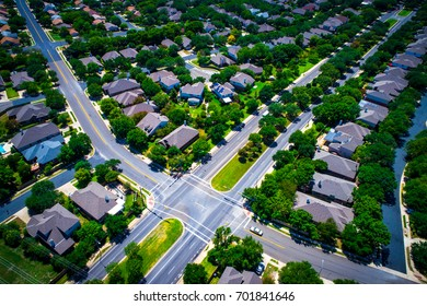 Aerial Drone View Above Austin Texas Suburb Summer Homes For Sale as Real Estate Ramps up in the Capital of Texas intersections and all way stops modern suburb layout North ATX