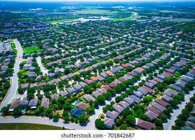Aerial Drone View Above Austin Texas Suburb Summer Homes For Sale as Real Estate Ramps up in the Capital of Texas deep perspective homes as far as the eye can see