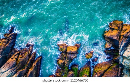 Are Aerial drone view above California beach near San Francisco Bay Area Pacific Ocean gorgeous landscape turquoise blue surf waves crashing along mountain coast