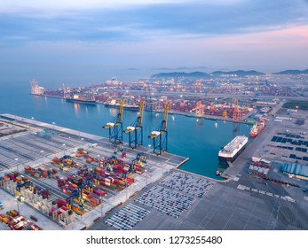 Aerial drone view above dockyard. Scenic view of cargo industrial commercial port in dawn. Professional business logistics and transportation of cargo ship.