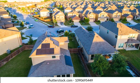 Aerial drone view above Solar Panel Rooftop in suburb modern new development community houses and homes in Austin , Texas , USA climate change and renewable energy cost for solar energy