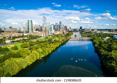 Aerial drone view above Town Lake over looking Austin Texas with the 2018 Downtown Skyline Cityscape afternoon sunshine during summer fun