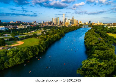 aerial drone view above town lake , a long view of the Colorado river extending down to the downtown view of skyscrapers and office buildings in the background - Austin Texas skyline cityscape 2019