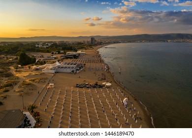 Aerial drone view of beach of sea resort Sunny Beach, Bulgaria at sunset