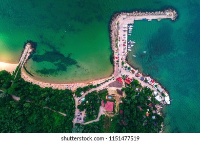 Aerial drone view of beautiful beach and fishing village. Euxinograd, Varna, Bulgaria. Aerial drone view of sea and coast above Varna, Bulgaria.