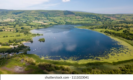Aerial drone view of a beautiful lake surrounded by rural farmla