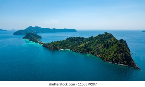 Aerial drone view of a beautiful remote tropical island surrounded by coral reef (Mergui Archipelago, Myanmar)