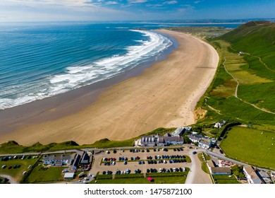 Aerial drone view of the beautiful sandy beach at Rhossili on the Gower peninsula of Wales