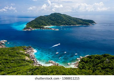 Aerial drone view of beautiful tropical islands with crystal clear waters and lush greenery (Similan Islands, Thailand)