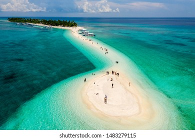Aerial drone view of a beautiful tropical island with sandy beach surrounded by Coral Reef (Kalanggaman Island, Philippines)