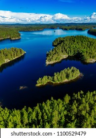 Aerial drone view of blue lakes and green forests. Beautiful summer landscape in Finland.