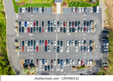 Aerial drone view of a busy corporate parking lot in a business park in Parsippany, New Jersey