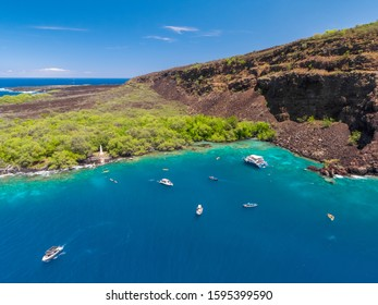 Aerial drone view the Captain James Cook Monument in Kealakekua Bay, Big Island, Hawaii. The monument marks the spot where James Cook was killed in a fight with native Hawaiians in 1779.