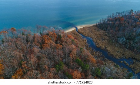 An aerial drone view of the Chesapeake Bay along the shore of Calvert Cliffs State Park, Maryland, an area famous for its plentiful prehistoric Middle Miocene era fossils.