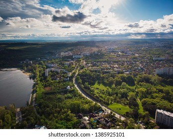 Aerial drone view of chisinau city in green spring with blue sky and clouds, Moldova