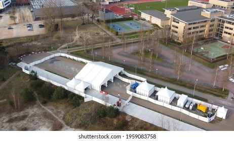 Aerial drone view of Cprona Covid-19 test site drive through center showing the white pop-up tents and way to enter the location usefull for rapid testing during 2019 2020 pandemic