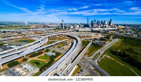 Aerial drone view of Dallas , Texas skyline cityscape massive construction of highways and overpasses transportation infruristructure