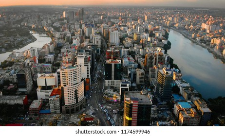 Aerial drone view of Dhaka during sunset.