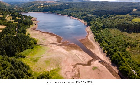 Aerial drone view of a drying reservoir in Wales during a heatwave (Llwyn-On Reservoir)